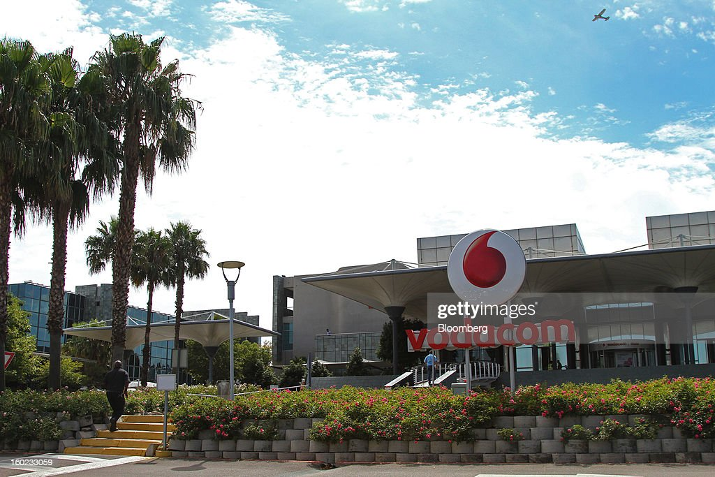Visitors approach the entrance to the headquarters of Vodacom Group Ltd., Vodafone's biggest African business, in Johannesburg, South Africa, on Monday, January 28, 2013. Almost two decades after Vodafone Group Plc entered Africa, the region -- where most people earn less than $2 a day and mobile phone towers run on diesel -- is turning into one of the company's biggest profit generators. Photographer: Nadine Hutton/Bloomberg via Getty Images