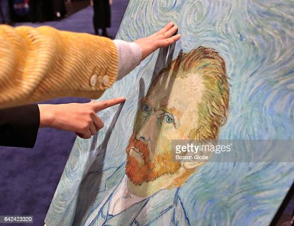 Visitors are allowed to touch and feel the brush strokes of a clone of a Vincent van Gogh selfportrait made at Clone of Cultural Properties by Tokyo...