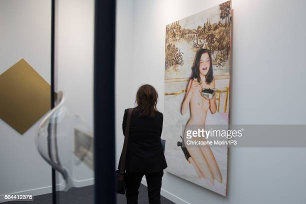 Visitors are looking a photography by Ida Tursic and Wilfried Mille during the opening of the 2017 International Contemporary Art Fair at the Grand...