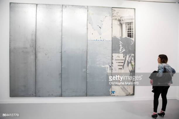 Visitors are looking at a work of art by Raymond Hains during the opening of the 2017 International Contemporary Art Fair at the Grand Palais on...