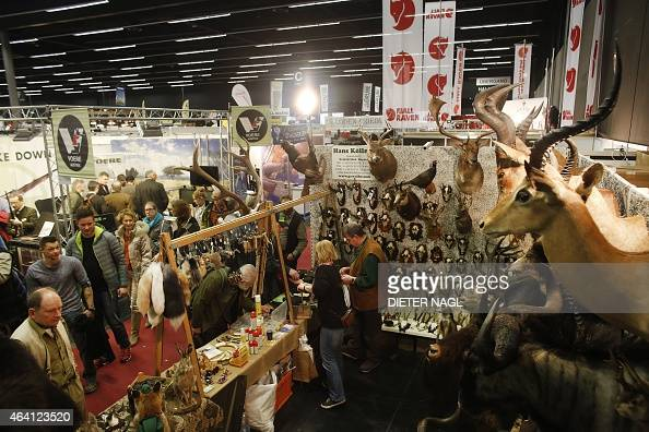 Visitors are pictured at the 'Hohe Jagd' hunting fair on February 22 2015 in Salzburg Austria AFP PHOTO / DIETER NAGL