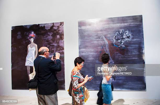 Visitors are pictured taking photographs at the Venice Biennale May 2015