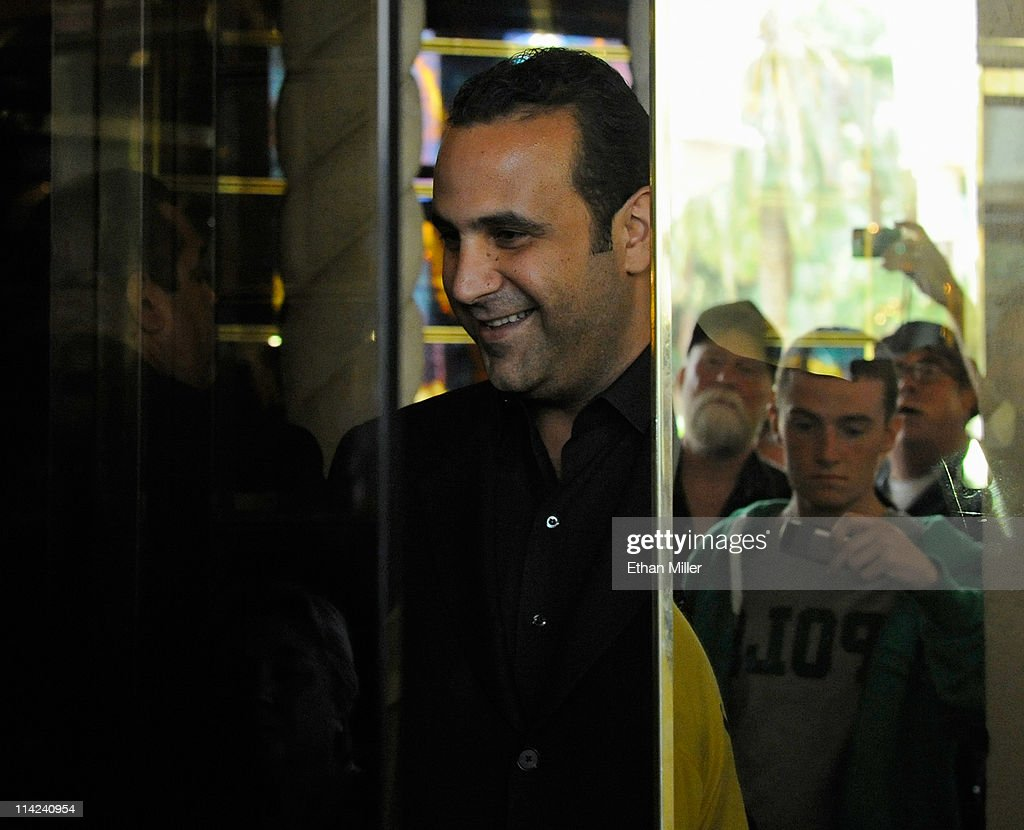 Visitors are reflected as they take photos of the front doors of the Sahara Hotel & Casino closing in front of SBE Entertainment Group CEO <a gi-track='captionPersonalityLinkClicked' href=/galleries/search?phrase=Sam+Nazarian&family=editorial&specificpeople=657664 ng-click='$event.stopPropagation()'>Sam Nazarian</a> on May 16, 2011 in Las Vegas, Nevada. The Sahara's current owner SBE Entertainment Group closed the 1,720-room resort, which first opened in 1952, and plans to redevelop the site in the future.