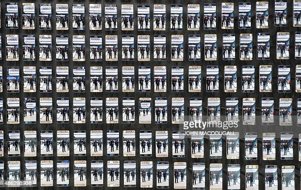 Visitors are reflected in hundreds of Samsung Galaxy S6 edge smartphones at the booth of South Korean electronics giant Samsung ahead of the opening...