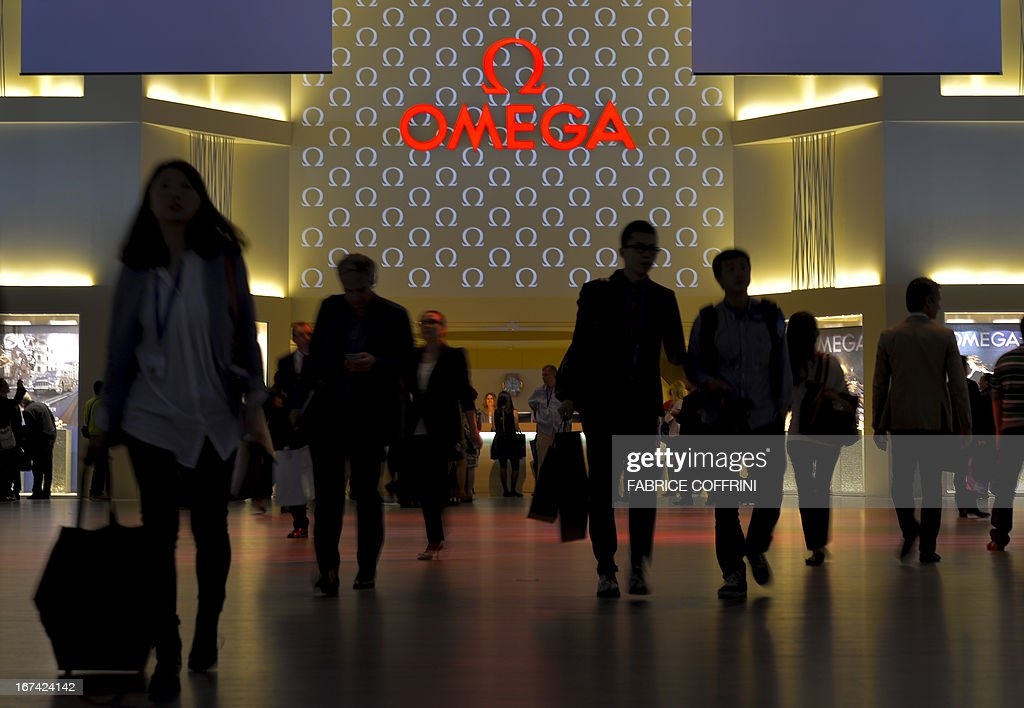 Visitors are seen at the booth of Swiss watchmaker Omega on the opening day of watch fair Baselworld on April 25, 2013 in Basel. The world's biggest watch fair Baselworld, which this year will host 1,460 exhibitors, including leading brands like Rolex, Patek Philippe and Omega, and is expected to draw some 100,000 visitors.