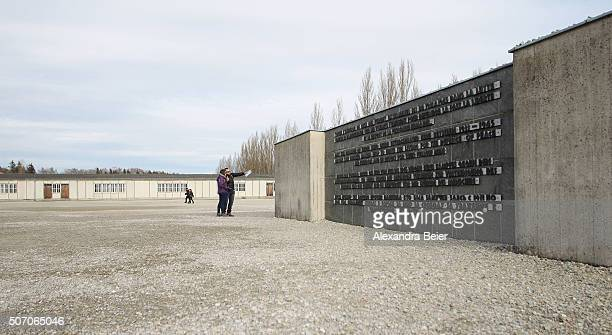 Visitors are seen at the concentration camp memorial site on January 27 2016 in Dachau Germany Thousands of people will come together today to...