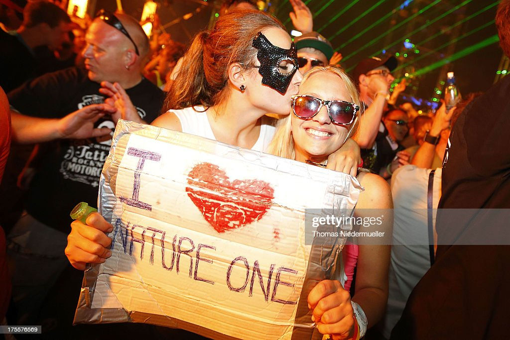 Visitors are seen at the 'Nature One' massive rave, held at the former US rocket base Pydna on August 3, 2013 in Kastellaun, Germany.