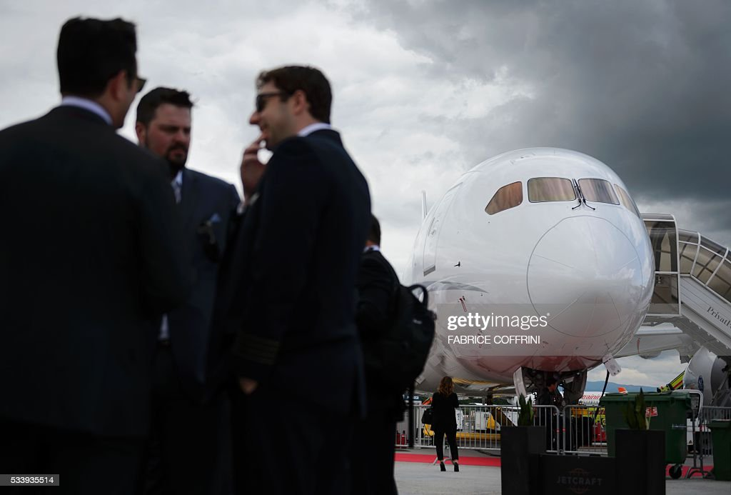 Visitors are seen at the static stand during the European business aviation show EBACE (European Business Aviation Convention & Exhibition) on May 24, 2016 in Geneva. / AFP / FABRICE