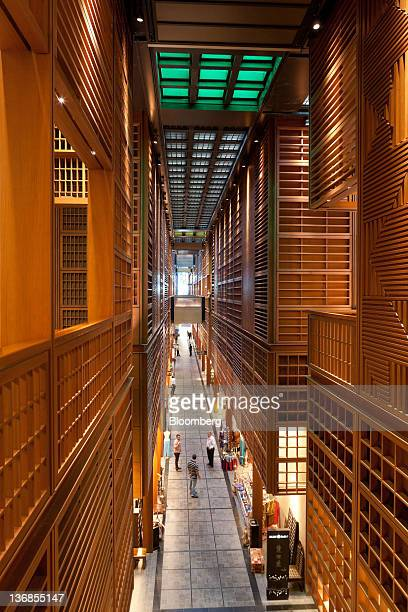 Visitors are seen from above on a storelined walkway in the Central Market souk an Aldar PJSC project designed by architects Foster and Partners Ltd...
