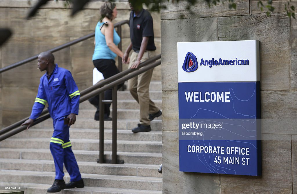 Visitors are seen on steps to the offices of Anglo American Plc in the Marshalltown district of Johannesburg, South Africa, on Friday, Oct. 26, 2012. Anglo American Plc Chief Executive Officer Cynthia Carroll , the first woman, external hire and non-South African to hold the job, will quit after Anglo lost $14 billion in value in the more than five years she was in charge. Photographer: Chris Ratcliffe/Bloomberg via Getty Images