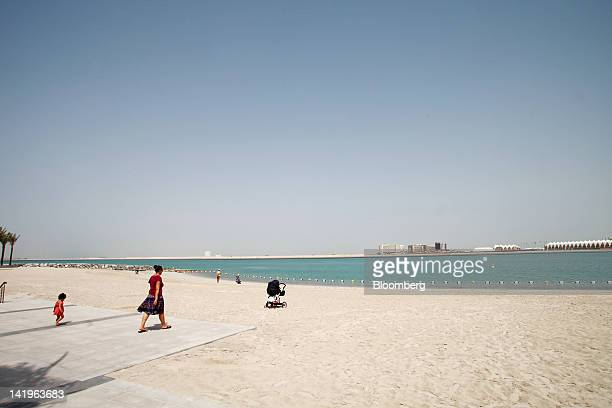 Visitors are seen on the beachfront at the Al Muneera development during a media tour organized by Aldar Properties PJSC Abu Dhabi's biggest real...