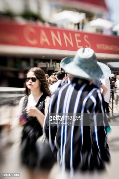 Visitors are seen outside the Palais des Festival during the 70th annual Cannes Film Festival at on May 22 2017 in Cannes France