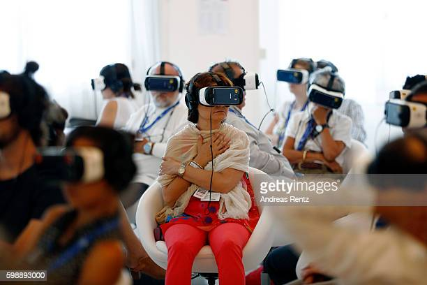 Visitors are seen watching selected scenes from the first ever feature length movie in Virtual Reality 'Jesus VR The Story Of Christ' during the 73rd...
