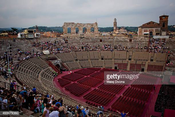 Visitors are sitting on the stone steps in the Arena of Verona on July 25 2014 in Verona Italy The famous Arena di Verona is popular for the annual...