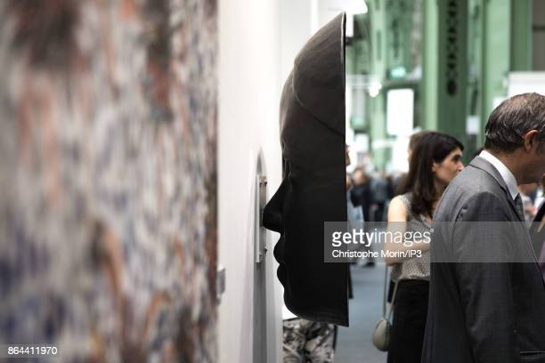 Visitors are speaking next to a work of art by French Artist Prune Nourry during the opening of the 2017 International Contemporary Art Fair at the...