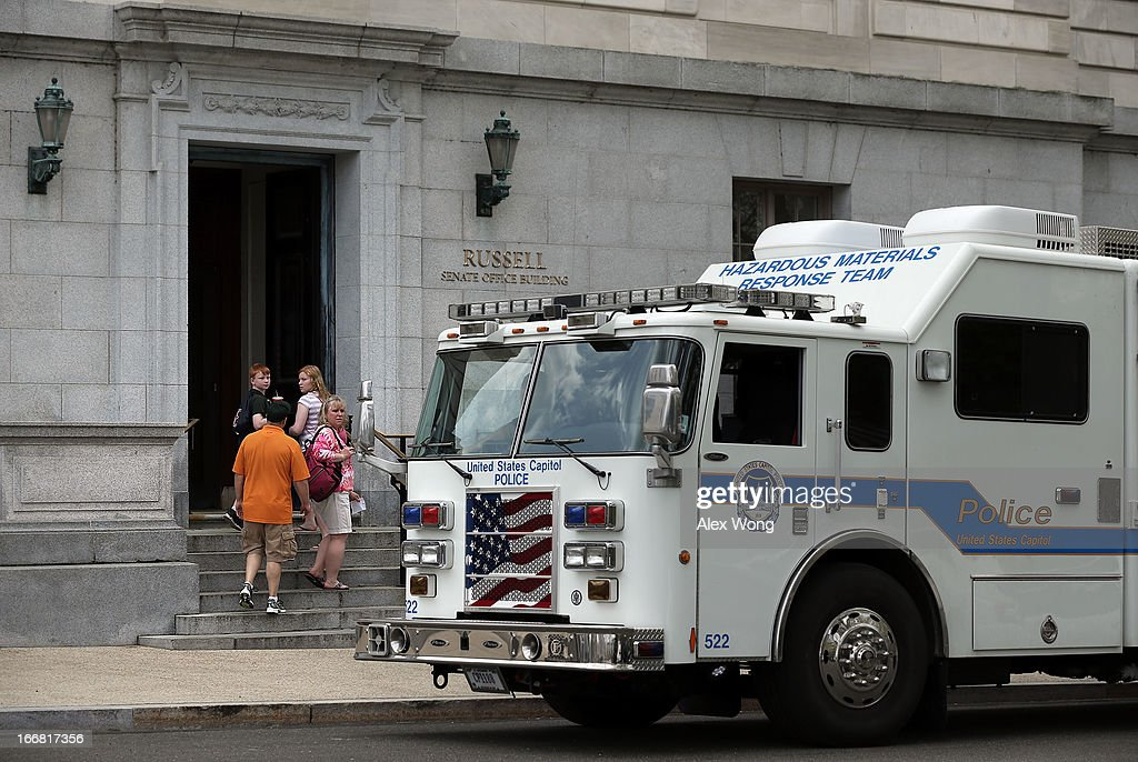 Visitors are stopped from entering Russell Senate Office Building as a truck from the U.S. Capitol Police Hazardous Materials Response Team parks outside April 17, 2013 on Capitol Hill in Washington, DC. U.S. Capitol Police were investigating three suspicious packages in the Hart and Russell Senate Office buildings.