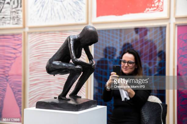 Visitors are taking pictures at a work of art by Anton Kern during the opening of the 2017 International Contemporary Art Fair at the Grand Palais on...