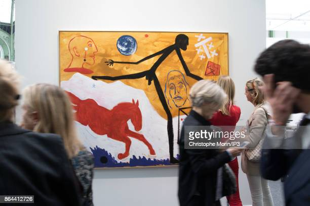 Visitors are walking next to a work of art by AR Penck during the opening of the 2017 International Contemporary Art Fair at the Grand Palais on...