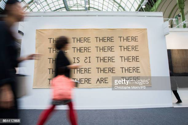 Visitors are walking next to a work of art by Robert Wilson during the opening of the 2017 International Contemporary Art Fair at the Grand Palais on...