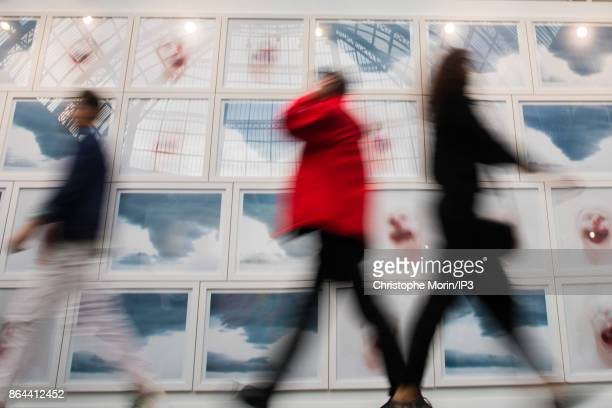 Visitors are walking next to a work of art by Xavier Hufkens during the opening of the 2017 International Contemporary Art Fair at the Grand Palais...