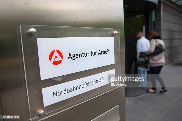 Visitors arrive at a Agentur fuer Arbeit employment office in Stuttgart Germany on Monday April 14 2014 German unemployment fell for a fourth month...
