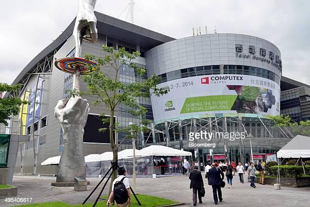 Visitors arrive at the Computex Taipei 2014 expo at the Taipei Nangang Exhibition Center in Taipei Taiwan on Tuesday June 3 2014 Computex runs...