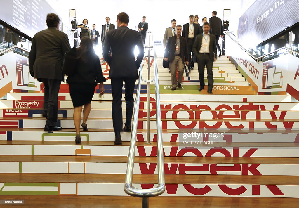 Visitors arrive for the opening of the International Market for Retail Real Estate (MAPIC) on November 14, 2012 in the southeastern French city of Cannes. The event held until November 16, gathers thousands of retailers, investors, local and regional authorities, and retail property professionnals from around the world.