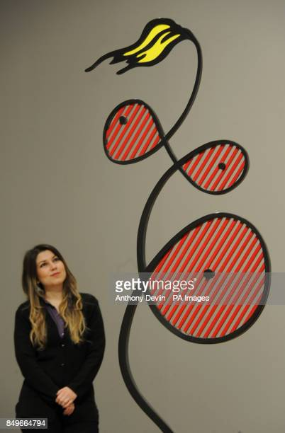 Visitor's Assistant Hilal Ozelci views Roy Lichtenstein's sculpture Galatea 1990 during the press preview for Lichtenstein A Retrospective at Tate...