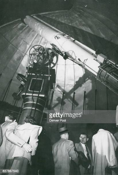 Visitors at Chamberlin Observatory crowd around the institution's telescope Credit Denver Post