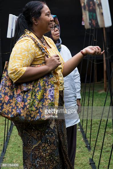 Visitors at quotMencari Amangquot by Ridwan Siregar a photo exhibition about RIDHWAN SIREGAR a freelance photographer from Indonesia held Jakarta on...