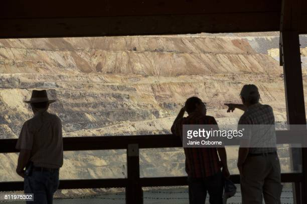 Visitors at the Berkeley Pit Visitor Information and Viewing Stand take a look at the toxic Berkeley Pit on July 6 2017 in Butte Montana Formerly an...