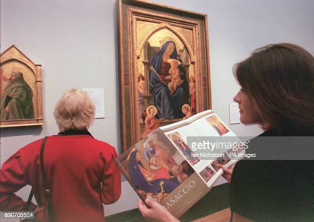 Visitors at the National Gallery enjoy a preview of Masaccio's Pisa altarpiece The only surviving fragments of the work painted in 1426 are reunited...