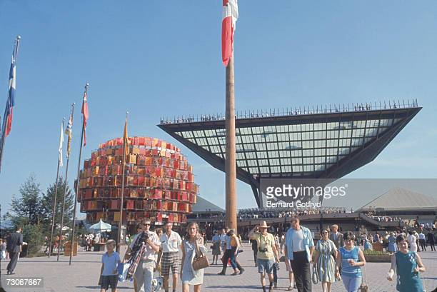 Visitors at the the 1967 International and Universal Exposition enjoy the plaza in front of the Canadian Pavillion and the Tree of People Montreal...