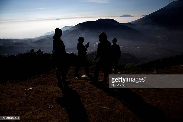 Visitors at the top of Sikunir Mountain in Dieng Dieng plateau in Central Java is part of the district of Banjarnegara and Wonosobo regency It lies...