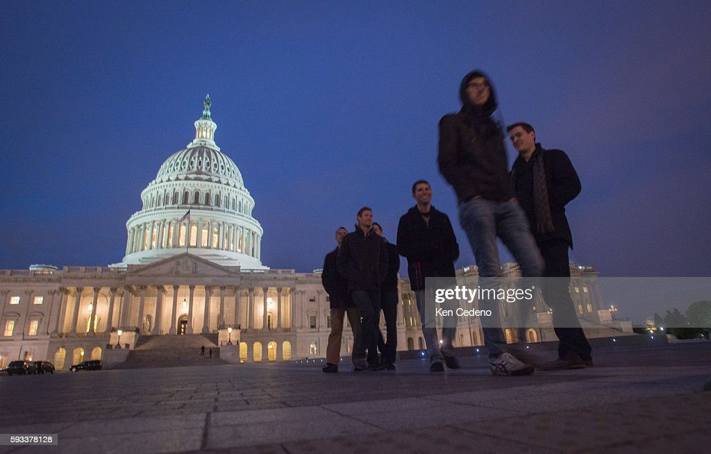 Visitors at the US Capitol January 1 2013 as US lawmakers work hard toward a midnight deadline averting hundreds of billions of dollars in tax...