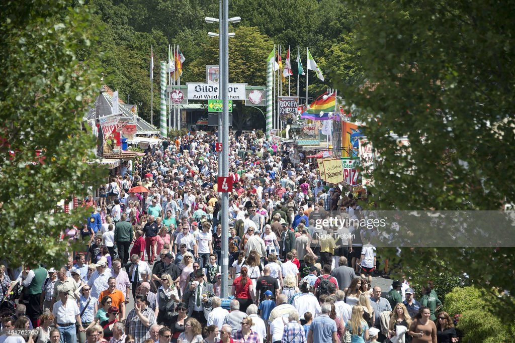 Visitors at the world's largest shooting fair, known as Schutzenfest, on July 6, 2014 in Hanover, Germany. A Schutzenfest, or German 'Marksmen's Festival' is a traditional festival featuring a target shooting competition in the cultures of both Germany and Switzerland. Reports indicate that more than a million visitors are expected to attend the 2014 Marksmen's Festival.
