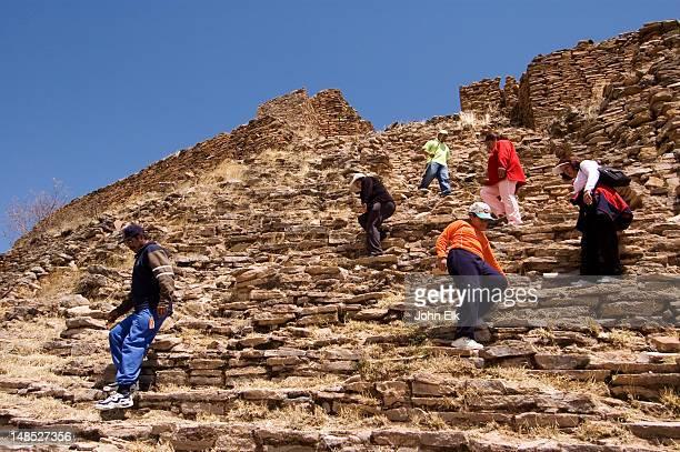 Visitors at Upper citadel at pre-Columbian archaeology site.