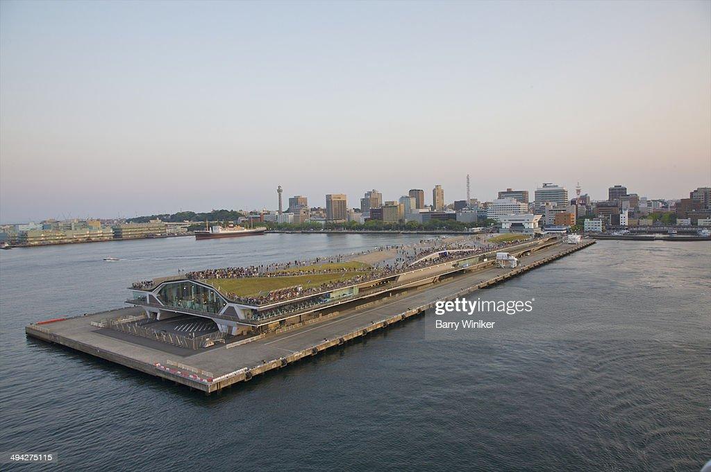 Visitors atop ship terminal on city pier