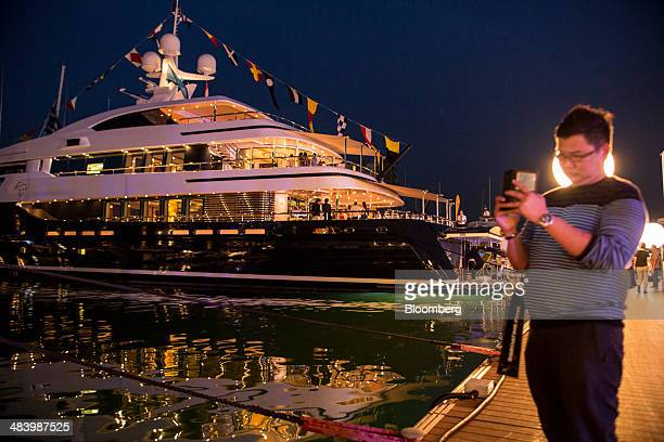 Visitors attend a cocktail function aboard the Cloud 9 super yacht manufactured by CMN Yachts at the Singapore Yacht Show in Singapore on Thursday...