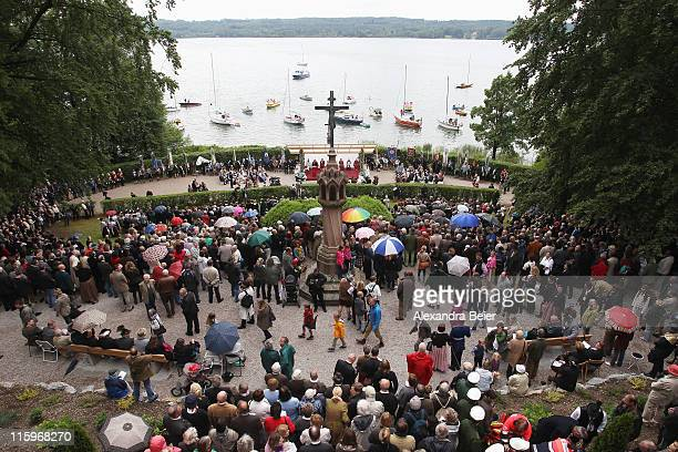 Visitors attend a religious mass to be held in honour of the 125th anniversary of the death of Bavarian King Ludwig II in front of the Votiv chapel...