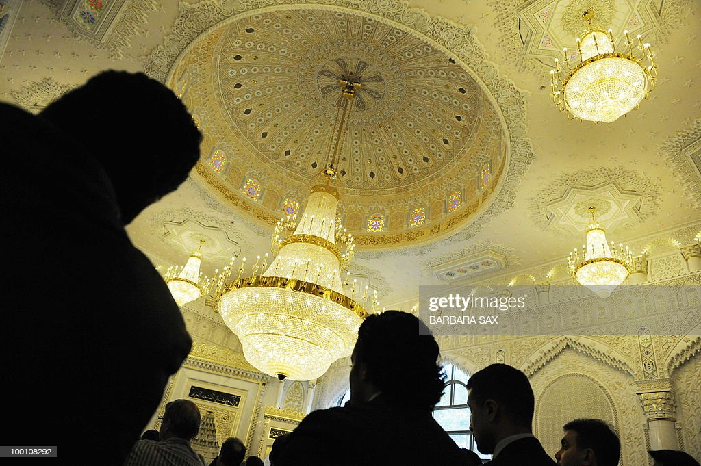 Visitors attend a service to inaugurate the new Omar Mosque in Berlin's Kreuzberg district during the inauguration of the Islamic Maschari Centre on May 21, 2010. The centre includes the mosque, a kindergarden, a school, a library, a travel agency and a shopping centre.