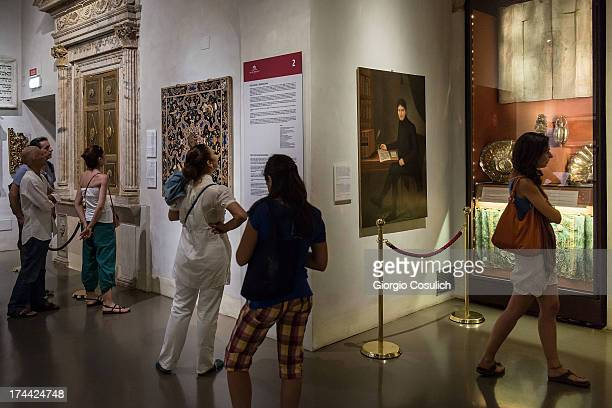 Visitors attend a tour of the Jewish Museum during the last day of the International Festival of Jewish Culture and Literature in the Ghetto district...