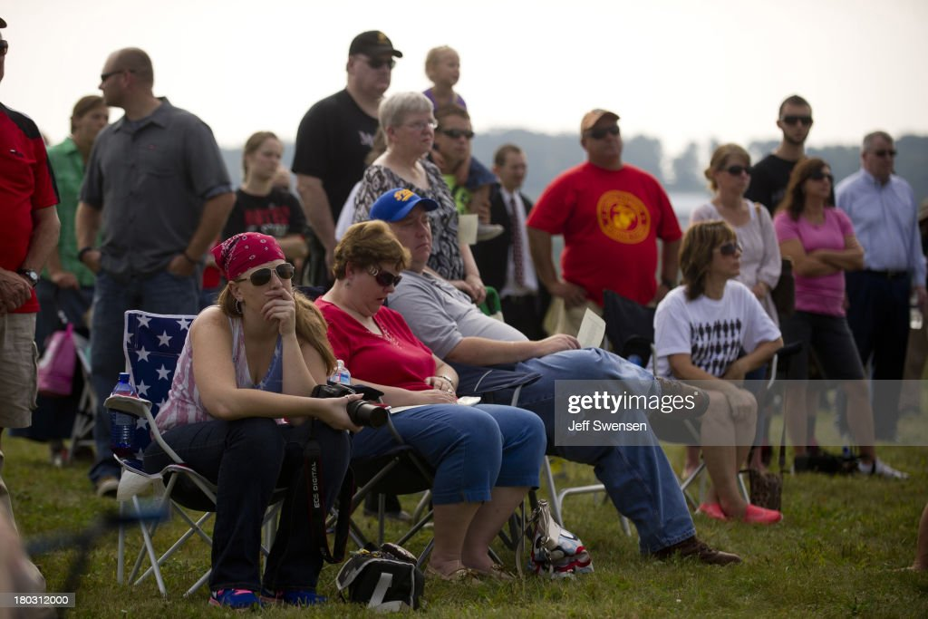 Visitors attend ceremonies at Flight 93 National Memorial commemorating the 12th anniversary of the 9/11 attacks on September 11, 2013 in Shanksville, Pennsylvania. The nation is commemorating the anniversary of the 2001 attacks, which resulted in the deaths of nearly 3,000 people after two hijacked planes crashed into the World Trade Center, one into the Pentagon in Arlington, Virginia and one crash landed in Shanksville, Pennsylvania.