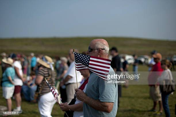 Visitors attend ceremonies at the Flight 93 National Memorial commemorating the 12th anniversary of the 9/11 attacks on September 11 2013 in...