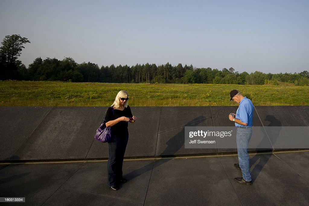 Visitors attend ceremonies at the Flight 93 National Memorial commemorating the 12th anniversary of the 9/11 attacks on September 11, 2013 in Shanksville, Pennsylvania. The nation is commemorating the anniversary of the 2001 attacks, which resulted in the deaths of nearly 3,000 people after two hijacked planes crashed into the World Trade Center, one into the Pentagon in Arlington, Virginia and one crash landed in Shanksville, Pennsylvania.