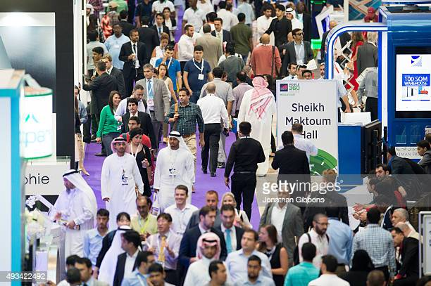 Visitors attend the 35th GITEX Technology Week at the Dubai World Trade Centre on October 19 2015 in Dubai United Arab Emirates