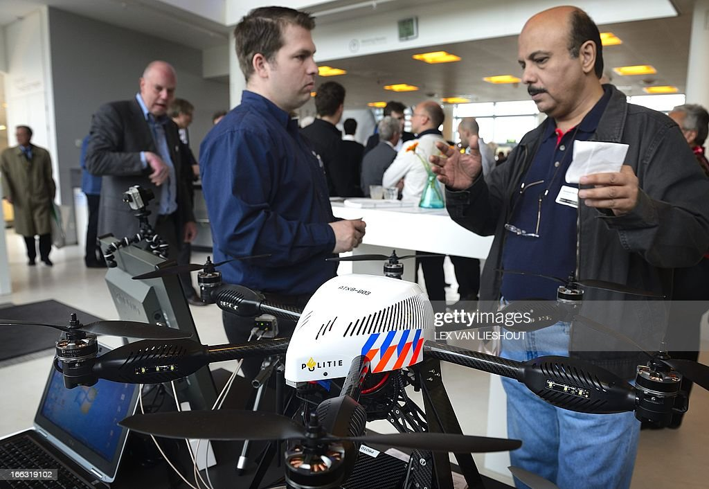 Visitors attend the fair on Unmanned Aerial Vehicles, the so-called drones and octocopters in the High Tech Campus in Eindhoven, on April 11, 2013. They are deployed predominantly for military applications, but also used in a small but growing number of civil applications, such as policing, firefighting, and nonmilitary security work.