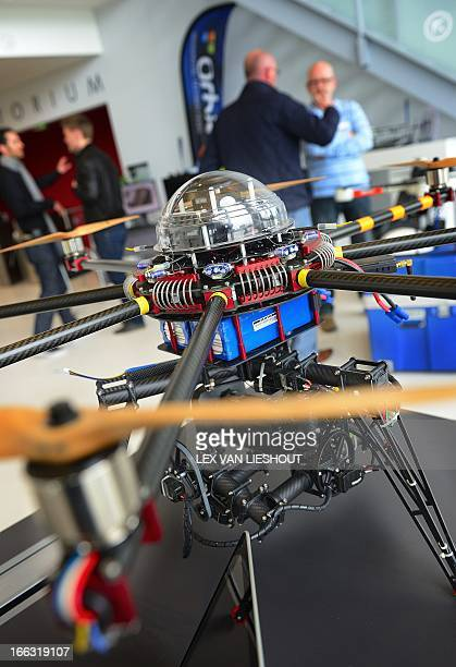 Visitors attend the fair on Unmanned Aerial Vehicles the socalled drones and octocopters in the High Tech Campus in Eindhoven on April 11 2013 They...