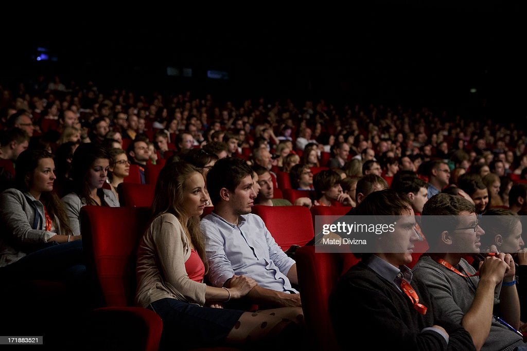 Visitors attend the film screening during the 48th Karlovy Vary International Film Festival (KVIFF) on June 29, 2013 in Karlovy Vary, Czech Republic.