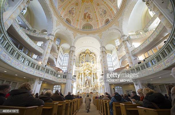 Visitors attend the Frauenkirche that was destroyed in World War II bombings as residents of Dresden eastern Germany commemorate the 70th anniversary...